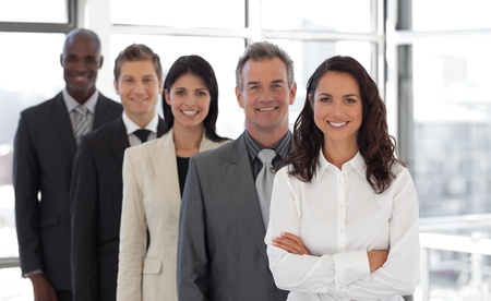 Hispanic Business woman leading a team of workers photo