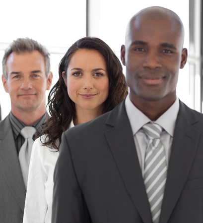 businessteamwork: Business leader with team in the background Stock Photo
