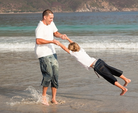 Father and son playing on a beach Stock Photo - 10114560