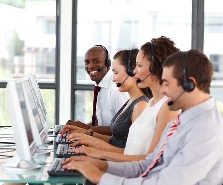 personal call: Smiling African-American businessman in a call center