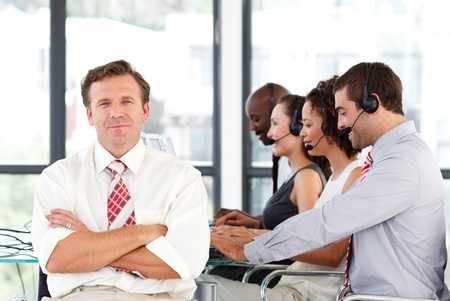 Senior leadership with crossed arms in a call center Stock Photo - 10112989