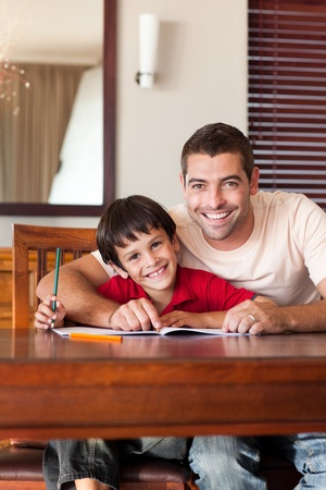 Radiant father helping his son for homework photo