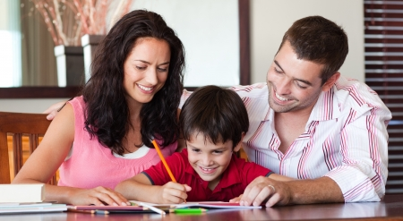 Radiant couple helping his son for homework photo