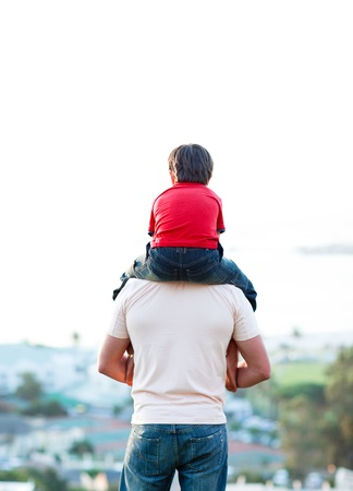 father and son: Young man giving child piggyback ride Stock Photo