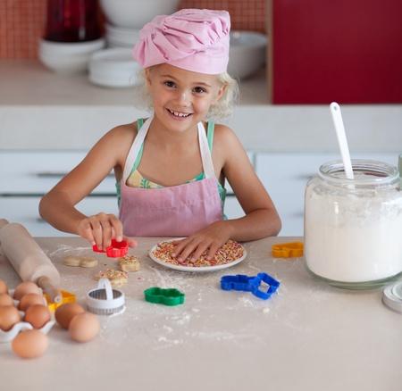 nice girl: Nice girl baking in a kitchen Stock Photo