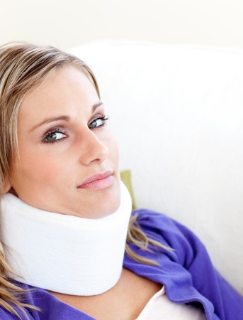 neck brace: Young woman with a neck brace looking in the camera