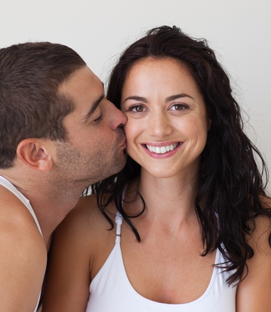 Close-up of a man kissing a beautiful woman  photo