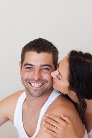 Woman kissing her handsome boyfriend photo