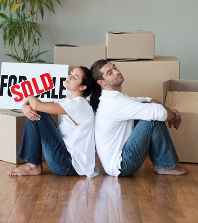 Happy young couple moving house  photo