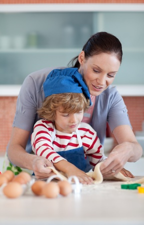 Little boy baking with his mother photo