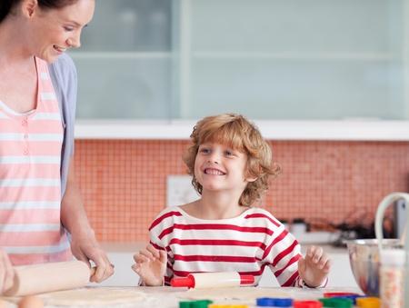 Cute boy baking photo
