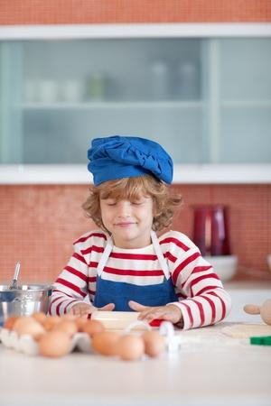 Smiling boy baking photo