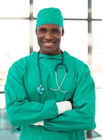 surgeon operating: Young confident doctor looking at camera
