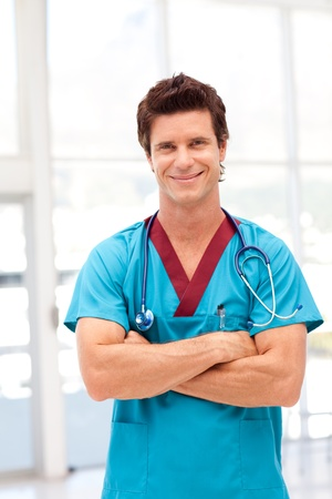 Portrait of a confident doctor in blue scrubs Stock Photo - 10131550