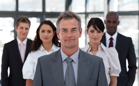 attire: Portrait of a confident business team looking at the camera Stock Photo