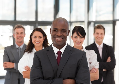 buisinessman: Smiling confident business team looking at the camera