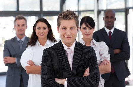 buisinessman: Confident business team looking at the camera
