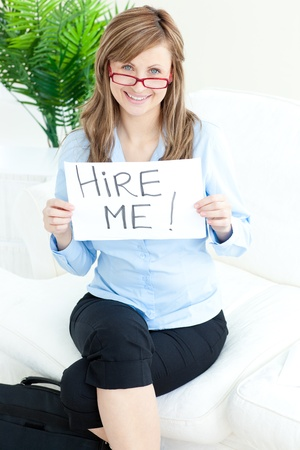 Confident charming businesswoman holding a paper Stock Photo - 10133319