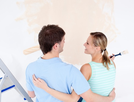 Affectionate couple painting a room Stock Photo - 10129905
