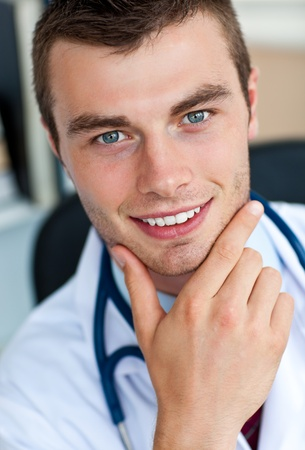 Portrait of a cheerful male doctor  photo