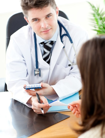 Young male doctor giving prescription to a patient Stock Photo - 10129793