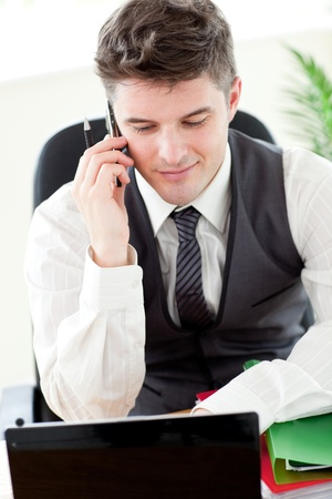 Confident young businessman talking on phone  photo