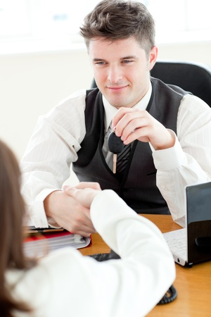 twain: Young attractive salesman giving car