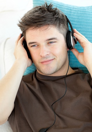 Handsome man with headphones listening to music   Stock Photo - 10134396