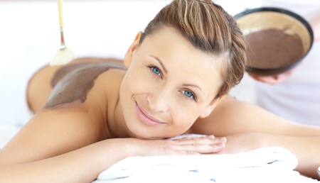 Beautiful woman enjoying a mud treatment Stock Photo - 10129755