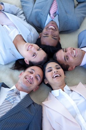 Business team on floor in a circle photo