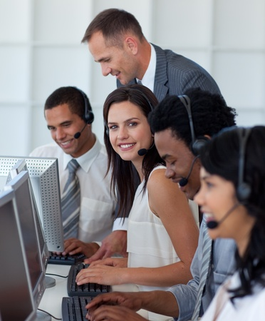 customer relationship: Businesswoman in a call center with her team and manager