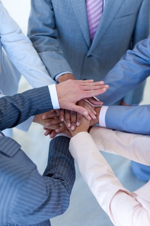 team hands: Close-up of internationalpeople with hands together