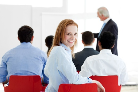 Smiling caucasian businesswoman at a conference photo