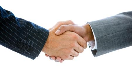 n�gocier: Gros plan d'un des hommes d'affaires se serrant la main