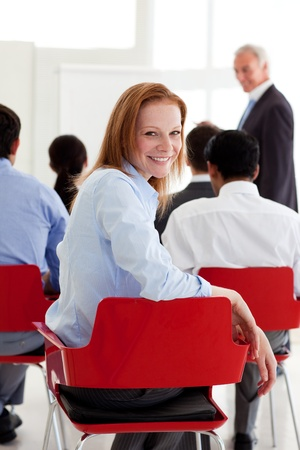 Attractive businesswoman smiling at the camera Stock Photo - 10133455