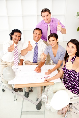 A group of architects with thumbs up in a meeting Stock Photo - 10134616