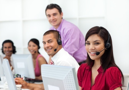 Positive business people with headset on working  Stock Photo