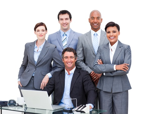 synergy: Diverse business people looking at the camera with a laptop
