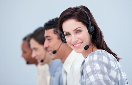 Attractive business woman and her team working in a call center Stock Photo - 10130104