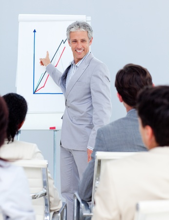 Positive mature businessman doing a presentation photo