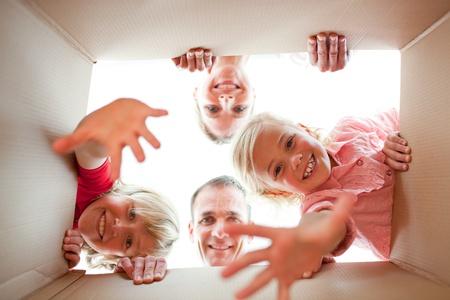 Joyful family unpacking boxes  photo