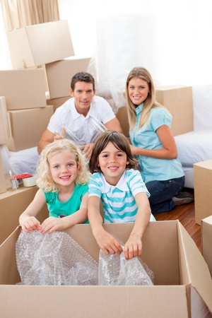 Smiling family packing boxes photo