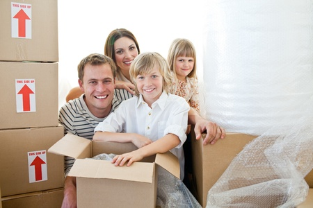 Loving family packing boxes photo