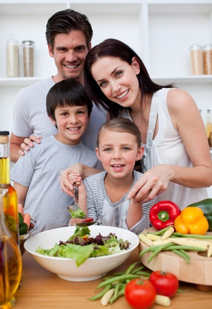 Smiling family cooking together photo