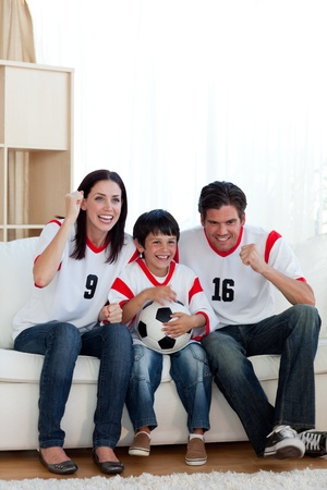 Lively famil ywatching football match photo