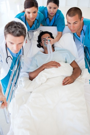 intensive: Multi-ethnic emergency team carrying a patient Stock Photo