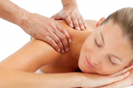 Serene woman enjoying a massage photo