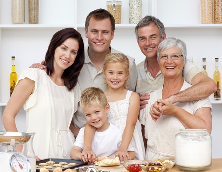 Happy family baking in the kitchen photo