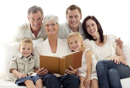 Grandmother reading a book to her children and parents Stock Photo - 10131149