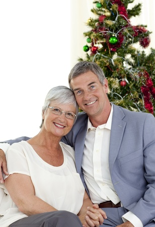 Portrait of mature couple celebrating Christmas photo